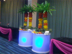 Four Fruit Palm Trees on illuminated stands at Delicious Fruits & Fountains Client Event