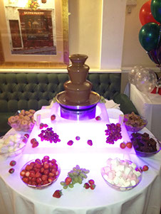 Mini Chocolate Fountains for hire from Delicious Fruits & Fountain with illuminated stand and dippers